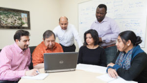 Professor Hasan Mukhtar and the scientists in his lab brainstorm new research concepts.