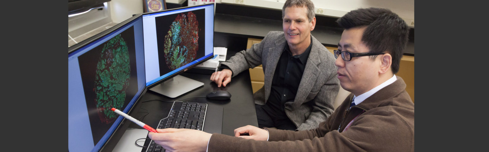 Picture of B. Jack Longley, MD, talking with Tony Xiao, MD, PhD